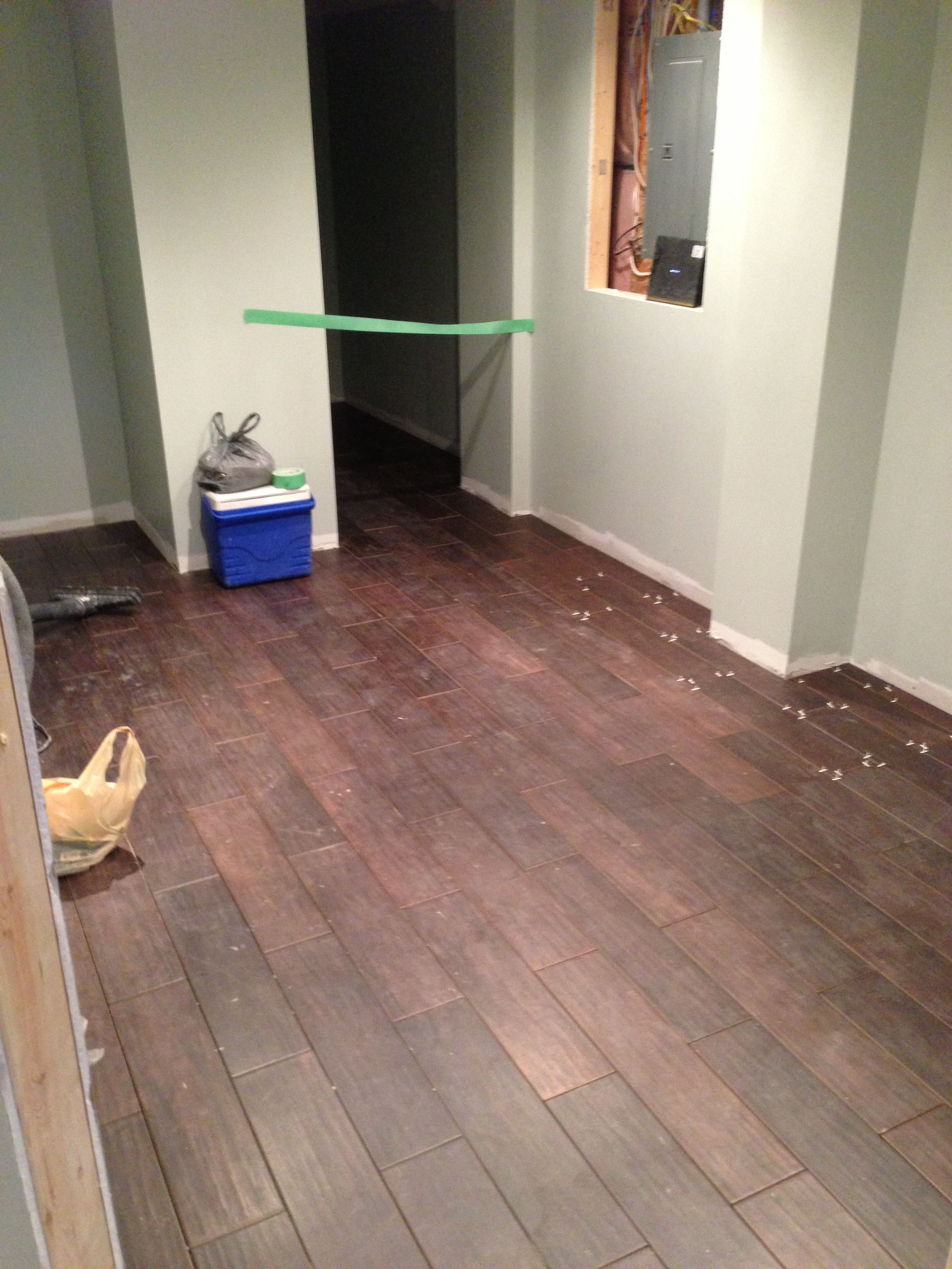 Lovely Porcelain Tile Basement