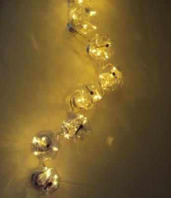 A wall mounted decorative light by Sabrina Lungo. Reuse Material ...