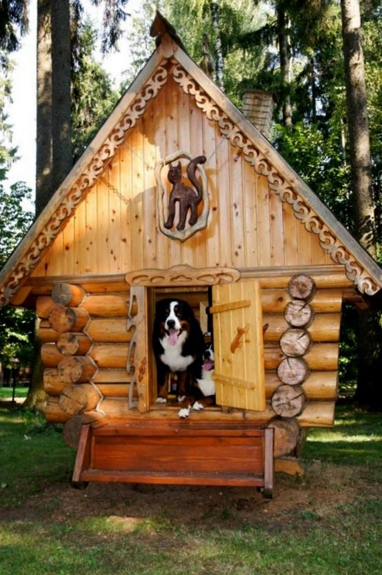This Looks Like A Log Cabin Dog House But It Has Cat Carving At