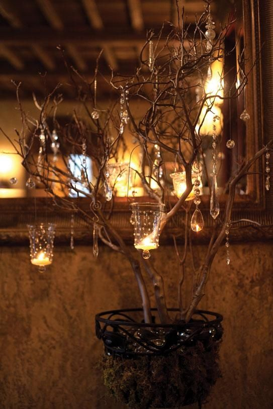 Branch centerpieces sparkle with crystals and candles. vintage-wedding