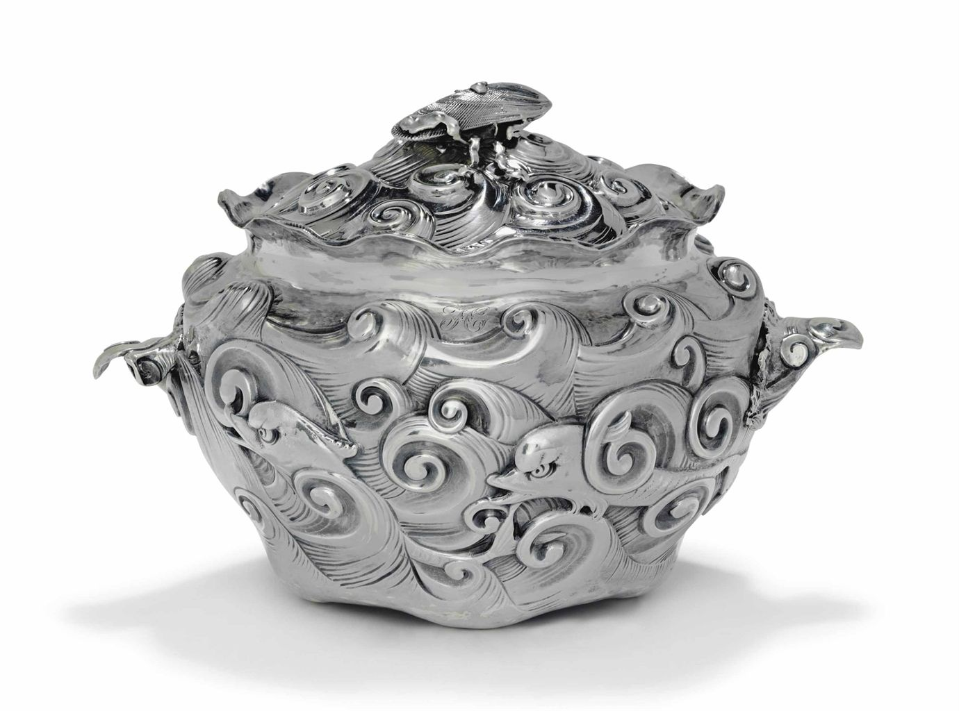 A SILVER TUREEN AND COVER MARK OF GORHAM MFG. CO., PROVIDENCE, 1883 Monogramed, marked under base, pattern '295' 11 ½ in. long; 45 oz. 10 dwt. (1,421 gr.)