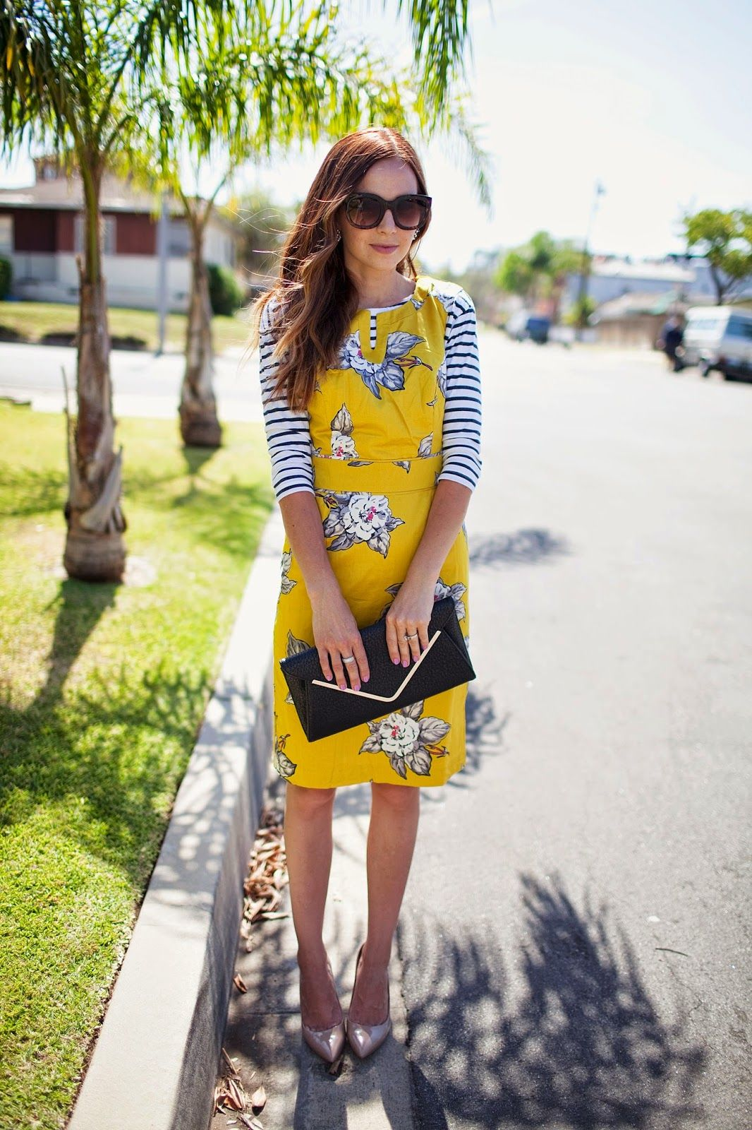de45d03ac33 A chilly spring day calls for cute layered pieces. Pair your favorite  yellow sundress with a black and white sleeve for some cozy style.