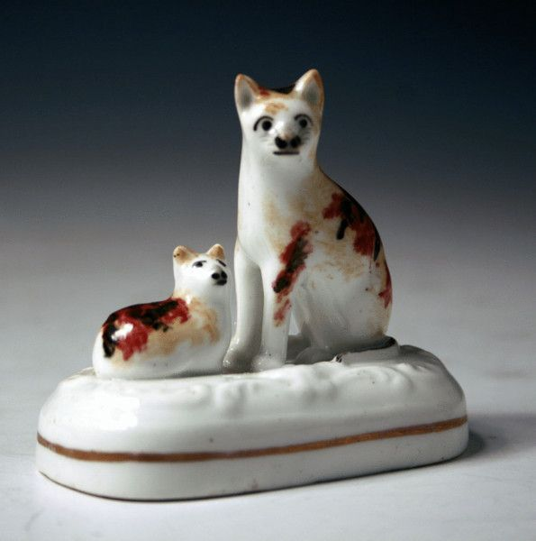 "Seated Cat with Laying Kitten. A Tortoise-Shell Coloured Cat and Kitten on a Base. Circa 1840. 2-3/4""."