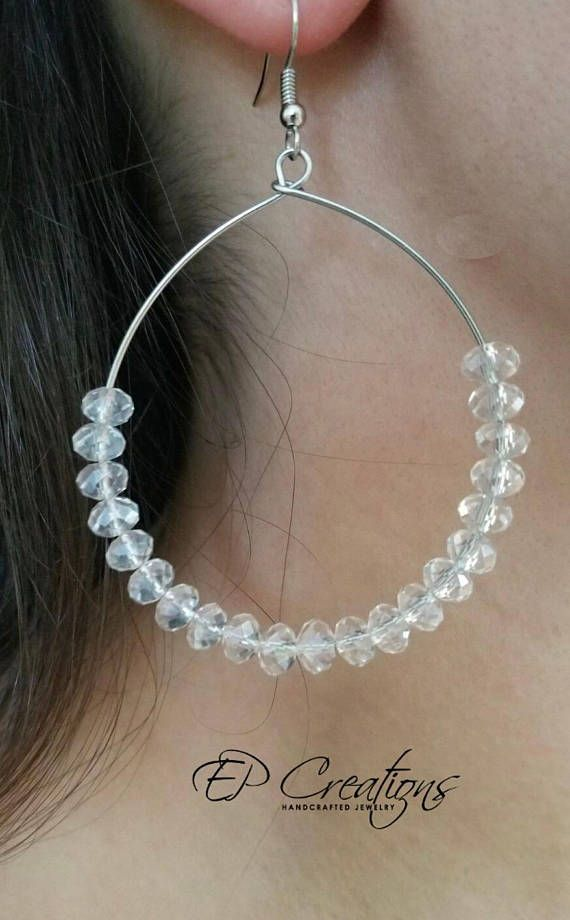 Handcrafted large, silver & clear crystal hoop earrings Elegant and unique large silver and clear crystal hoop earrings. Minimalist design of earrings will accessorize special occasion wardrobe as well as every day outfit. Earrings come with iron, nickel-free ear-wire, silver