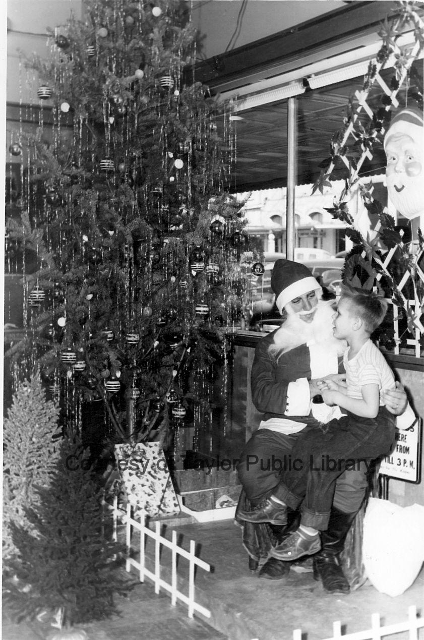 Dec. 2015 Boy on Santa's lap in a store on Main Street ...