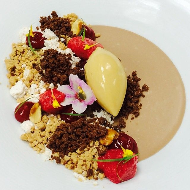 Chocolate Custard, Salted caramel Ice Cream , peanut butter snow , frozen. Chocolate sand, peanuts streusel, Raspberry by Antonio Bachour