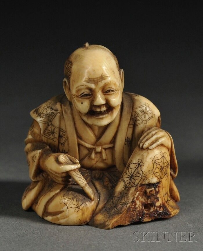 Ivory Netsuke, Japan, 19th century, carved as a seated man holding a brush, finely incised patterns to his robe, (loss), lg. 1 7/8 in.