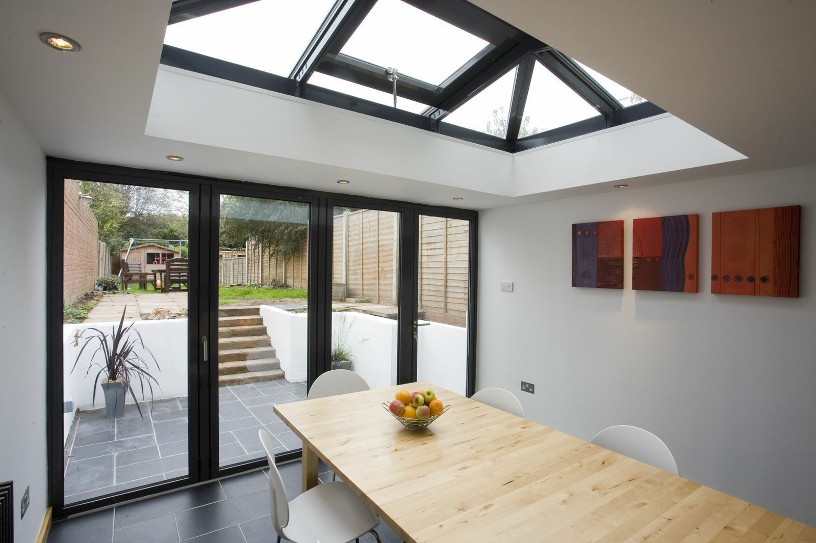 New extension with bifold doors and skylight veranda for Large skylights