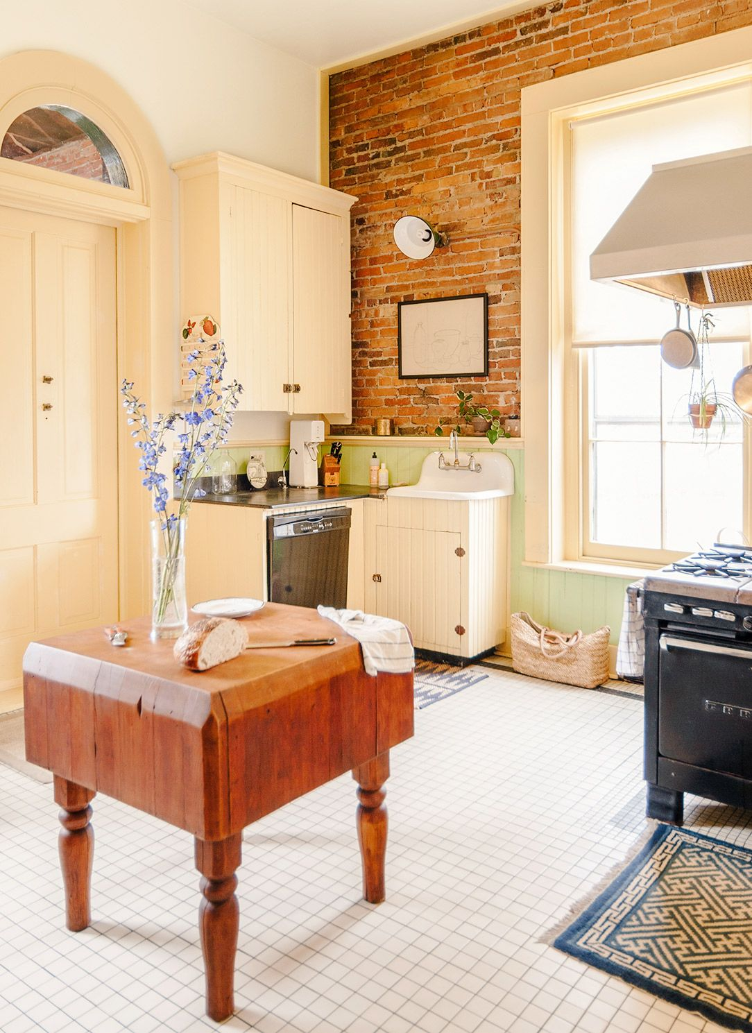 Tour a Stately and Stylish Historic Michigan Home | Exposed brick ...