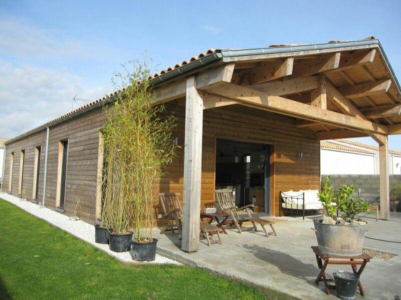 Maison ossature bois, bardage mélèze cl3, auvent traditionnel - maison bois en kit toit plat