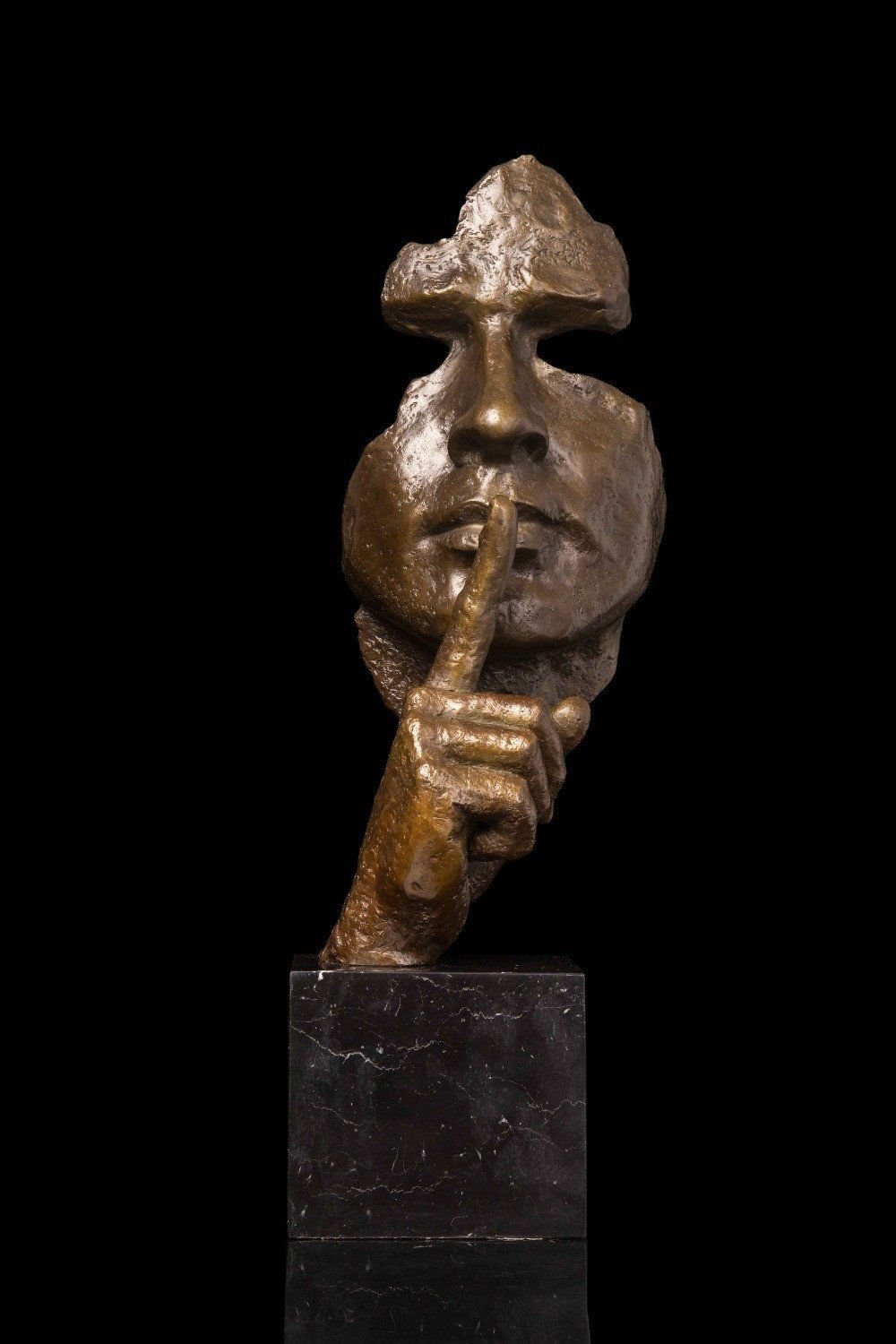 Antique bronze statue abstract face sculpture keep silence in