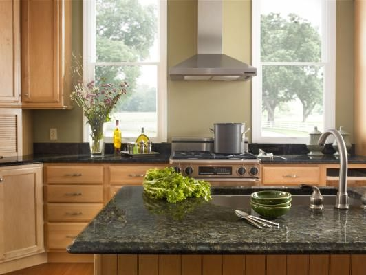 Light Kitchen Cabinets With Verde Peacock Countertops.