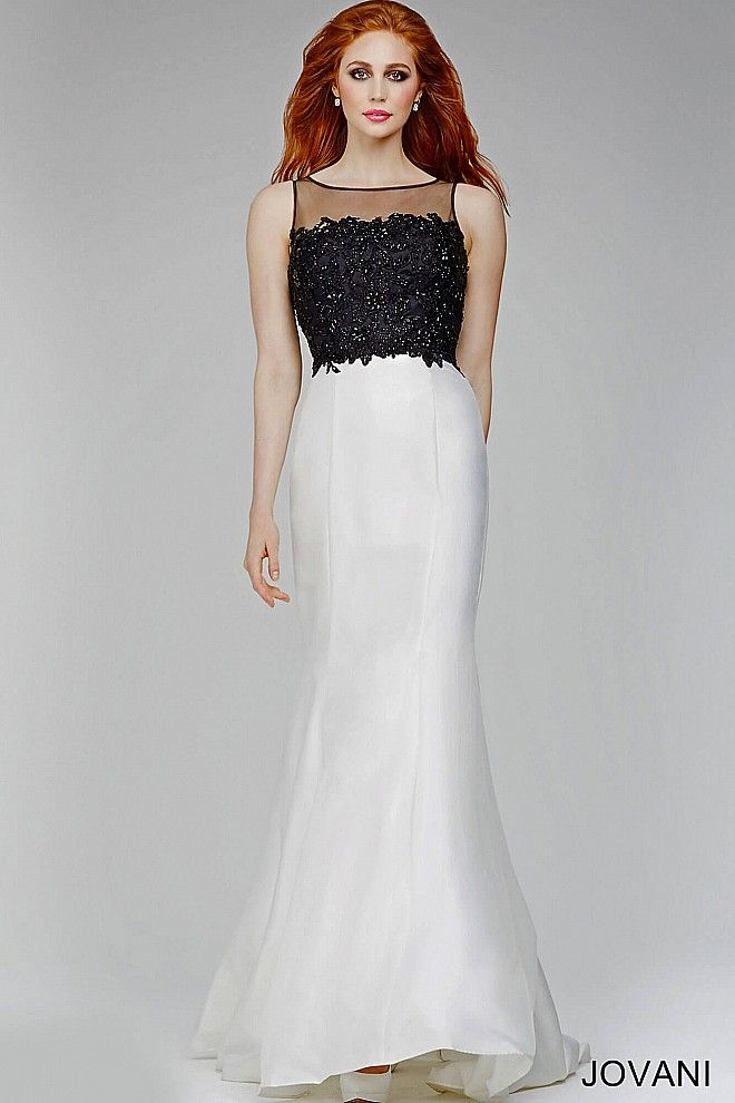 Floor length black and ivory dress features a sheer sleeveless neckline, black embellishments on the bodice, a sheer back and a zipper in the back.