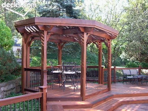 A Multilevel Backyard Deck With Open Gazebo Designed For Shade And