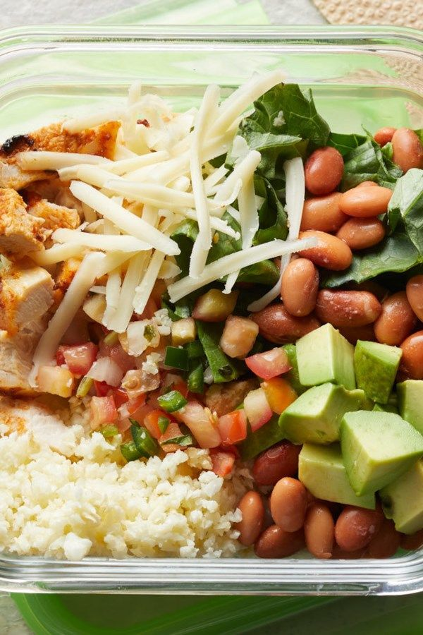 This easy-to-make and meal-prep burrito bowl is even better than takeout! You'll never miss the carbs in this protein-packed, super-flavorful meal that replaces the cilantro-lime rice with cauliflower rice. We love this with chicken but it would be just as delicious with shrimp. #lowcalorie #lowcal #lowcaloriefoods #lowcaloriemeals #lowcalorieideas #lowcalfoods #low #calorie #recipe #eatingwell #healthy