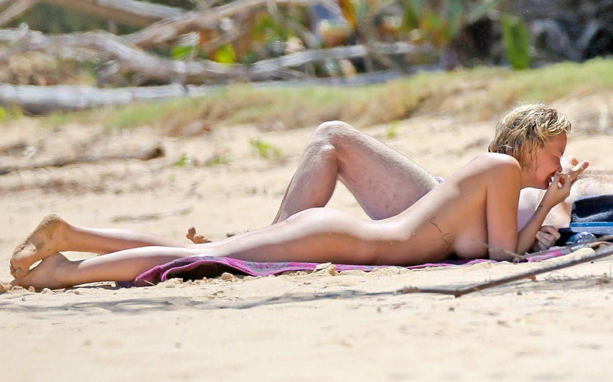 Lara Bingle naked on beach!