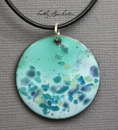 Calling all mermaids! This blue and green enamel pendant reminds me of the ocean! It is a base of a soft mint green with a blue on top. Then over that are sprinkles of teal, green, blues and more. All