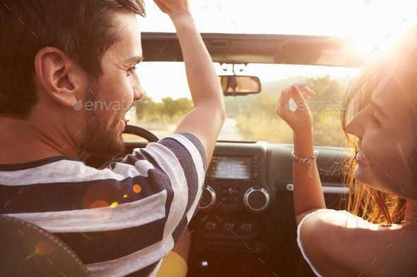 Young Couple Driving Along Country Road In Open Top Car by monkeybusiness. Young Couple Driving Along Country Road In Open Top Car#Driving, #Country, #Young, #Couple