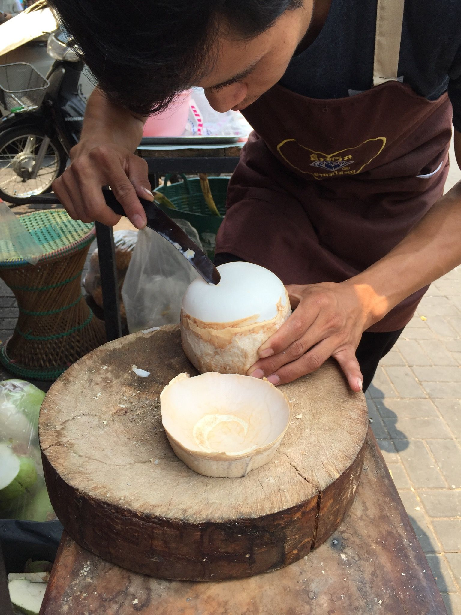 We took 3-4 hour walking food tour with Gade, owner of Elliebum Guest House. She mixed history with food, highly recommend. In this photo a guy is carving down a coconut to the skin, and you can stick a straw in and drink it.   http://elliebum.com/Elliebum.htm