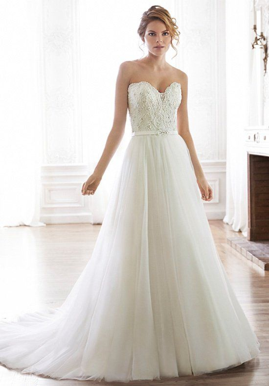Twinkling Swarovski crystals accent the bodice of this romantic ...
