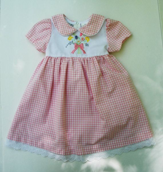 Adorable little girls vintage pink and white gingham cotton dress. Such a sweet little dress with puffy short sleeves and eyelet trim on the