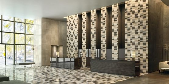"""The modern minimalism of this hotel lobby finds its perfect finish in our """"piano"""" texture in the """"cappuccino"""" palette, whose bouquet of colors matches the interiors adding the definitive touch of style. From the """"Opus"""" collection."""