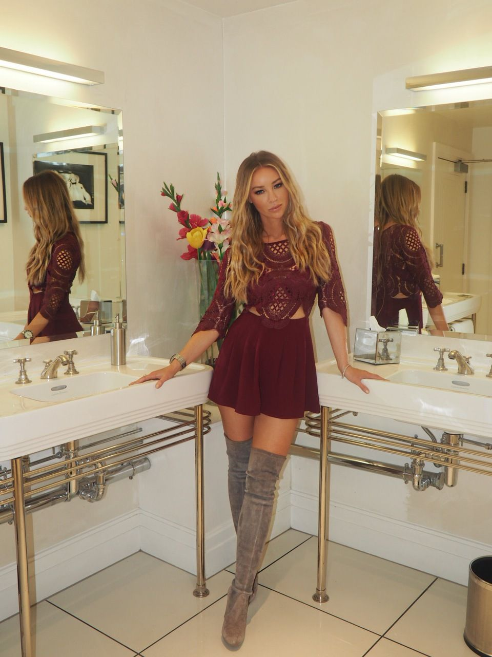 Lauren pope flashes a glimpse of her red bra in crochet playsuit