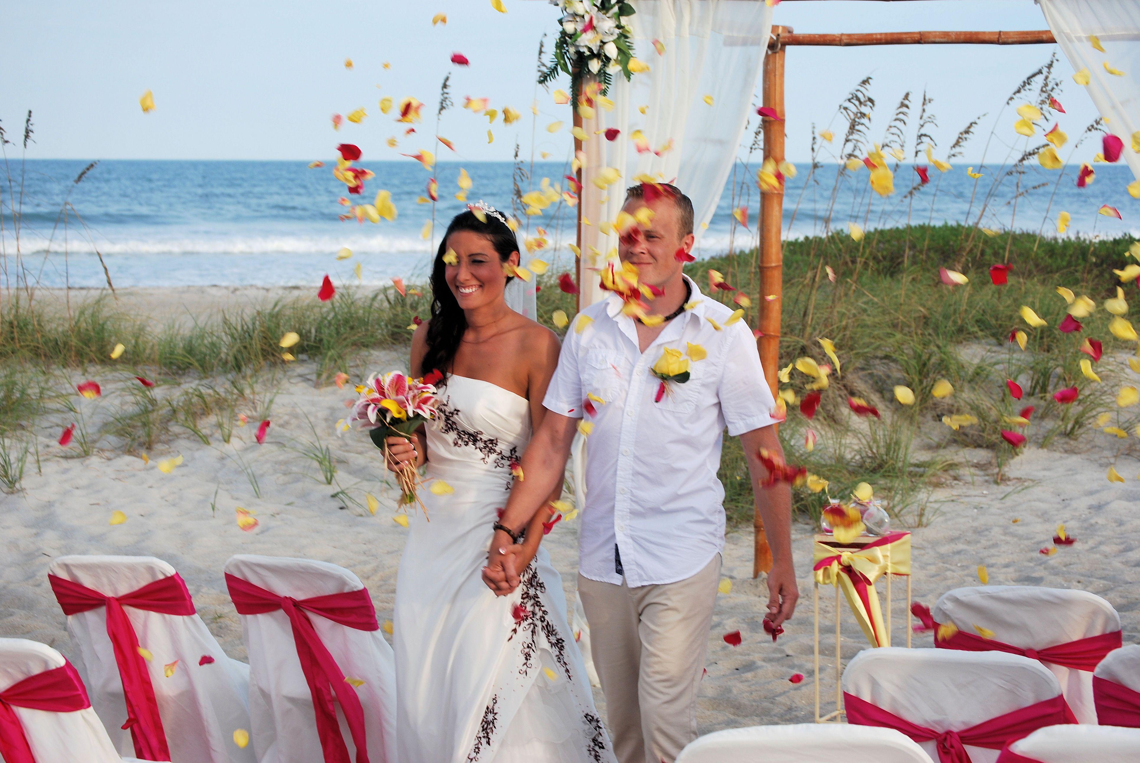 Florida Beach Wedding, tossing flower petals. www