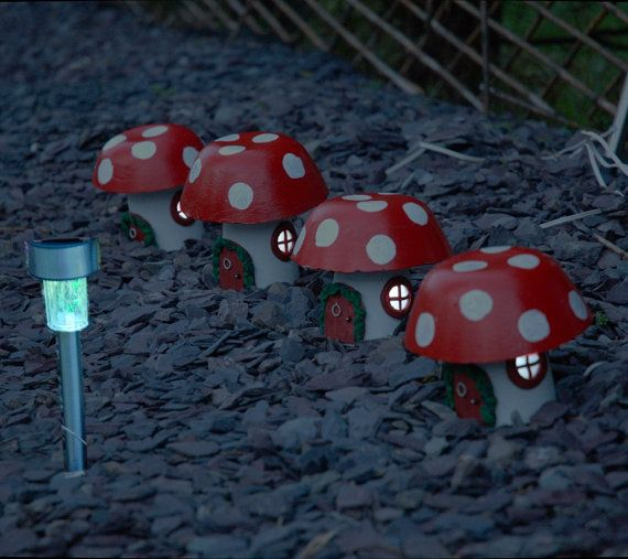 Light up fairy homes for your garden.  Buy a Toadstool Cottage fairy house and be enchanted.