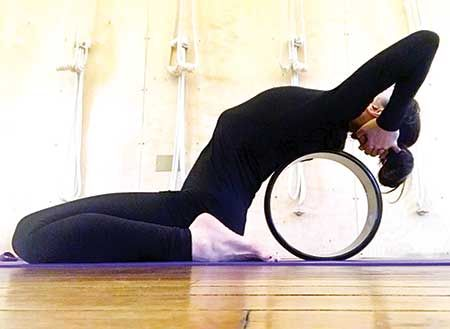 5 yoga wheel moves that will help quit hunching  health
