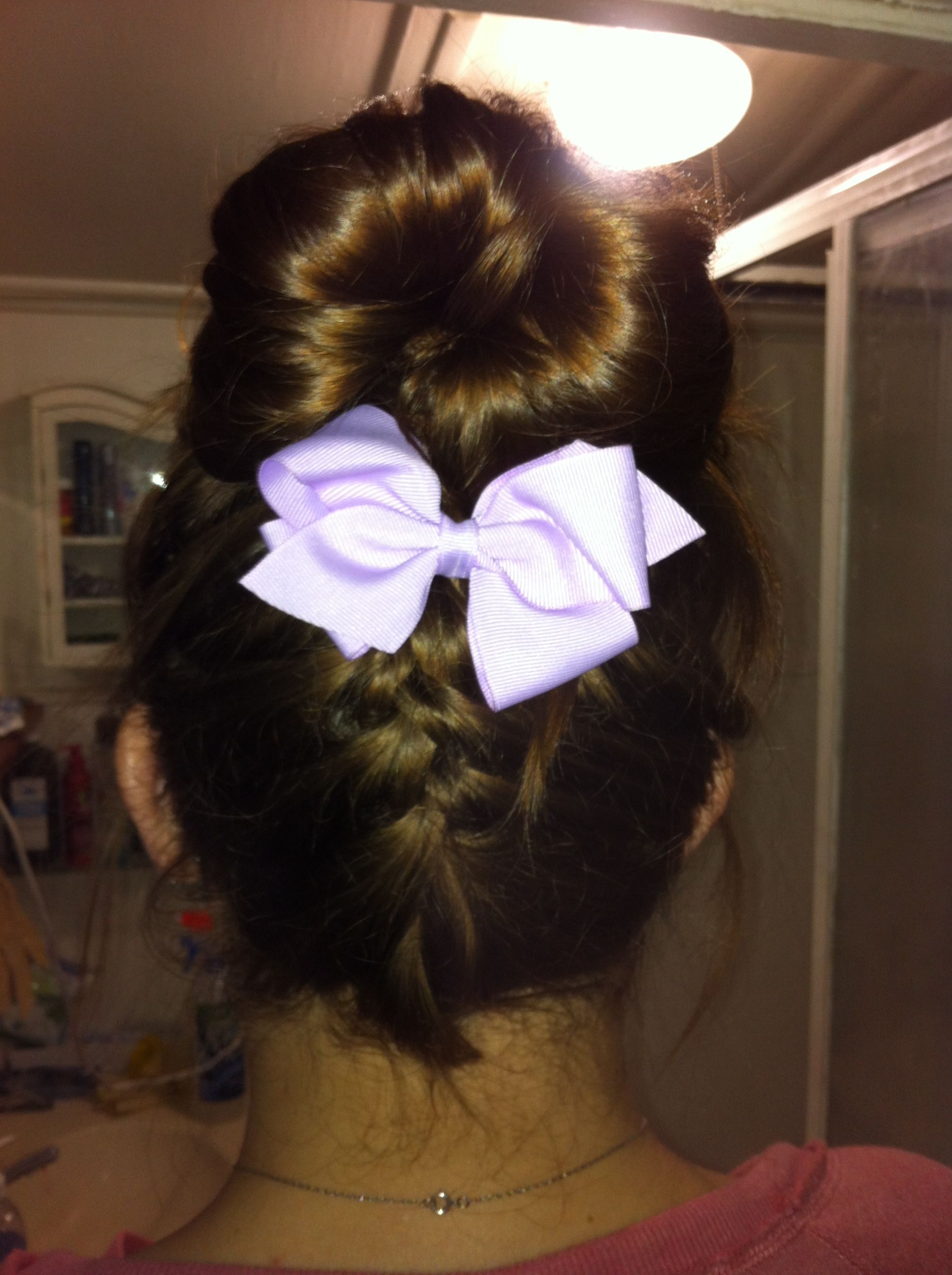 Bottom French braid into messy bun with a bow