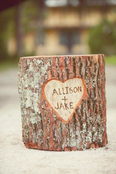 Tree stump with carved names. Cute centerpiece.