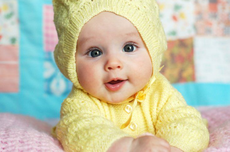 Baby Looking Cute In Yellow Dress Wallpaper. Download free