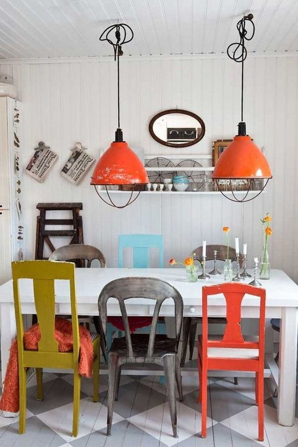 Dining room or restaurant décor idea using found pieces orange industrial barn lights painted orange ochre grey chairs white table all works