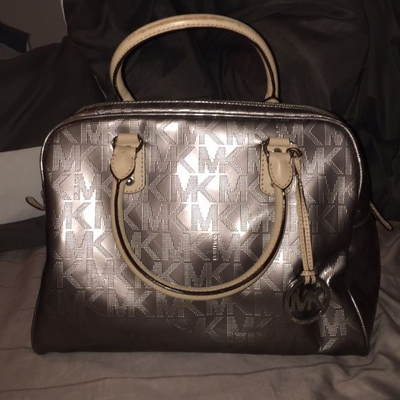Michael Kors Gun metal metallic Michael Kors tote, pre loved but great condition, some signs of wear on the handles as pictured Michael Kors Bags Totes