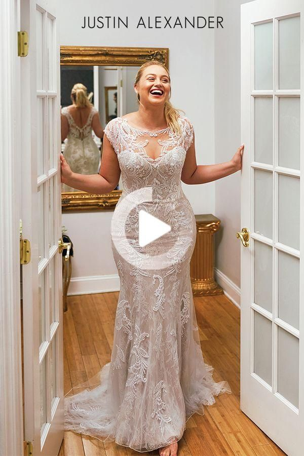 Shine on in this fit and flare wedding gown. The beautifully placed beaded lace appliques shown thro...