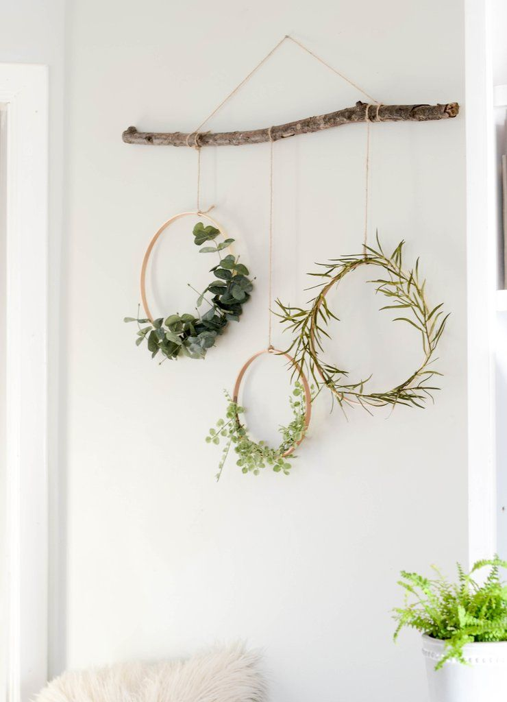 Wreaths Hanging From A Branch Branch Decor Winter Home Decor