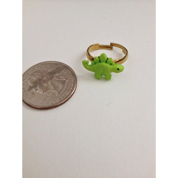 Mini Green Dinosaur Ring ($3.50) ❤ liked on Polyvore featuring jewelry, rings, green gold ring, yellow gold jewelry, gold jewelry, green ring and gold jewellery