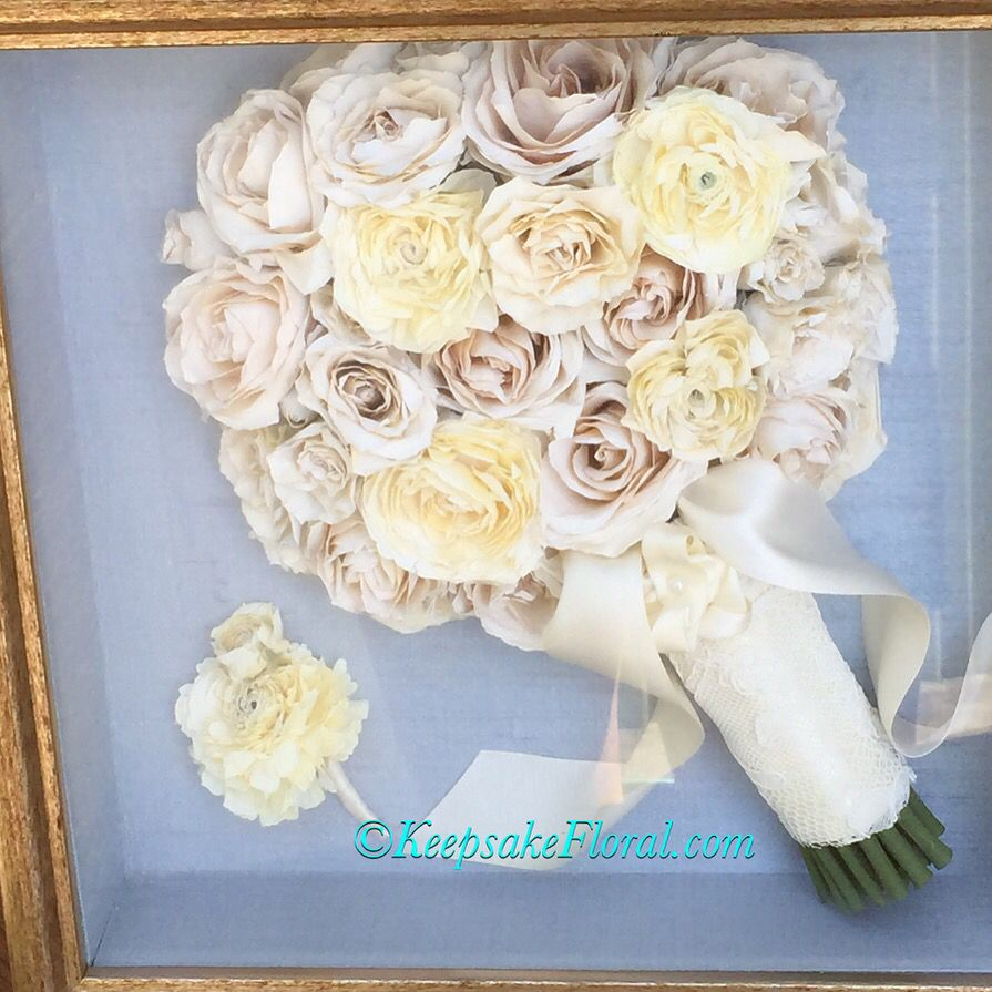 Classic rose and ranunculus bouquet preserved on a lovely blue linen, displayed in a custom shadowbox. #floralpreservation #keepsakefloral