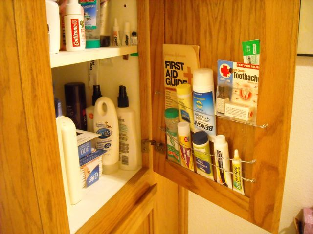 Organized cupboard storage a cheap and easy solution for for Cheap kitchen storage ideas