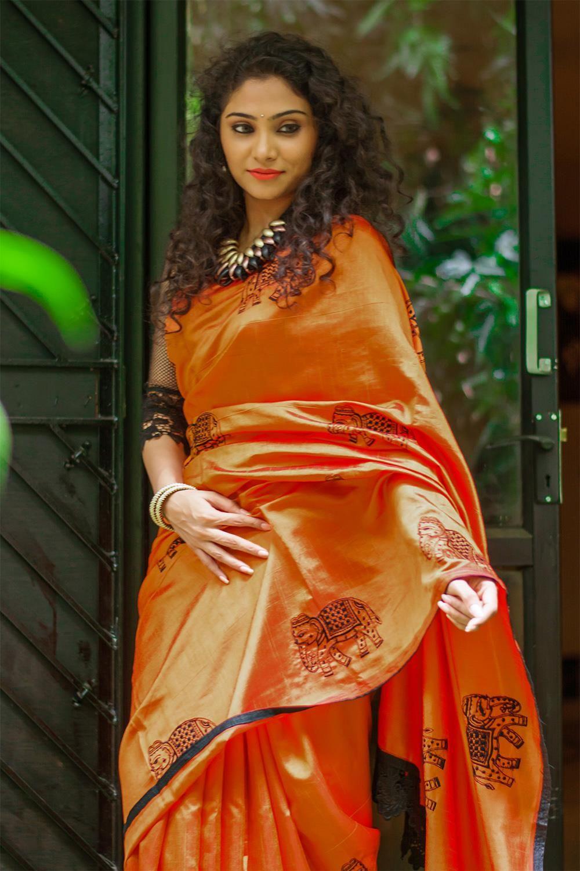 e9bf23f0c67c65 Rust orange semi raw silk saree with elephant threadwork motifs ...