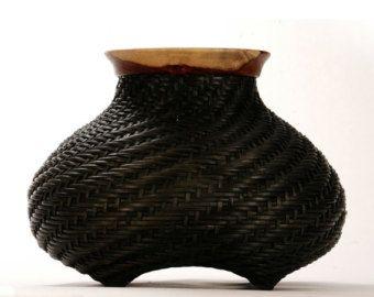Black handwoven basket with wooden rim