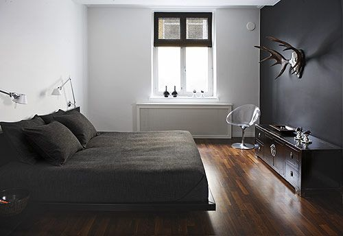 white walls + black accent wall + antlers