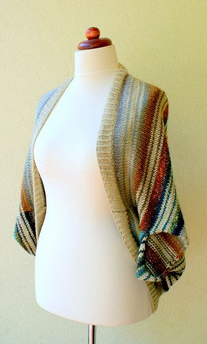 I love the colors in this shrug - very Southwestern. Not difficult on a standard or bulky knitting machine
