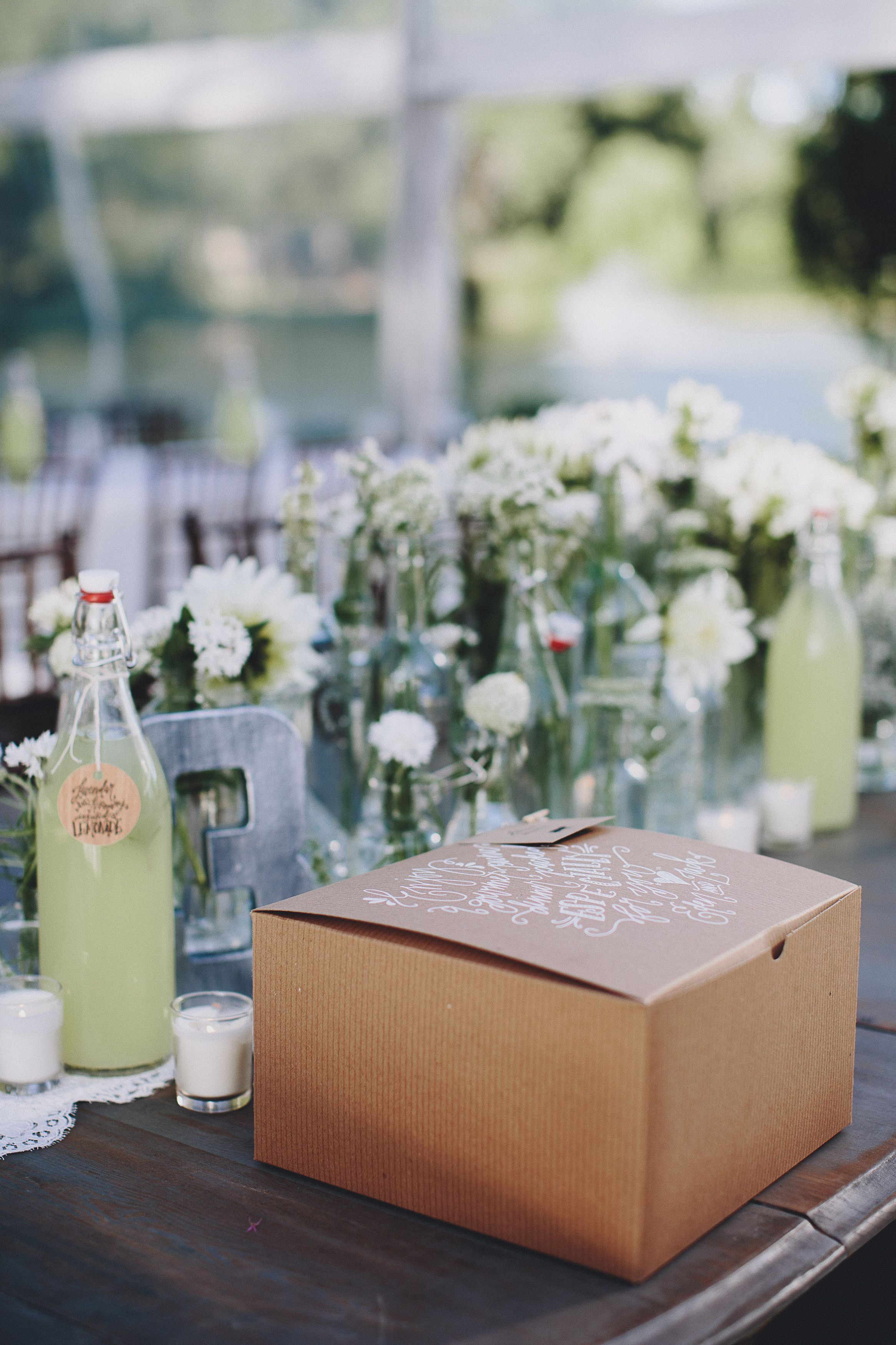 A simple picnic tablescape with boxed lunches and lemonade