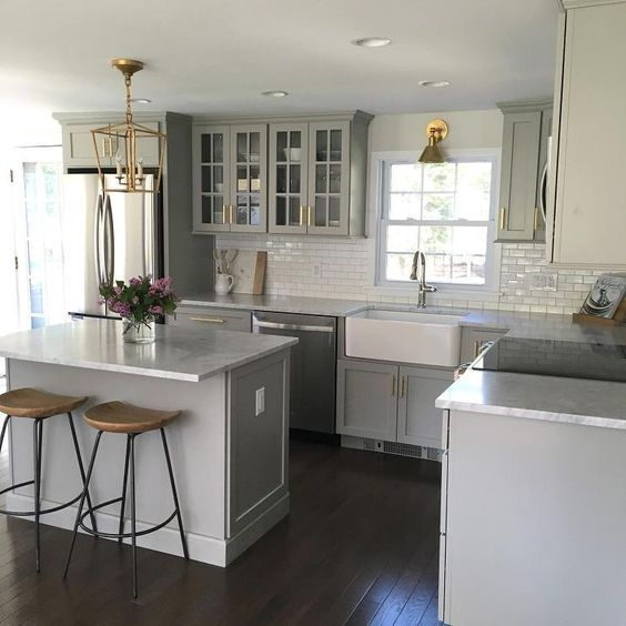 Gray Kitchen Features Gray Shaker Cabinets Adorned With Brass Pulls - Gray kitchen cabinets with marble countertops
