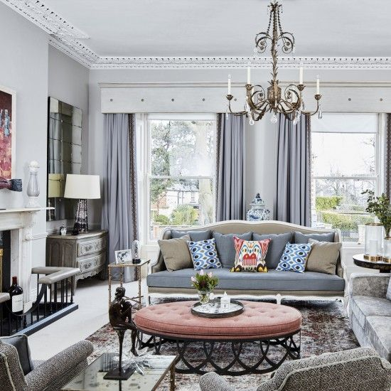 Elegant Living Room With Dove Grey Seating And Peach Footstool