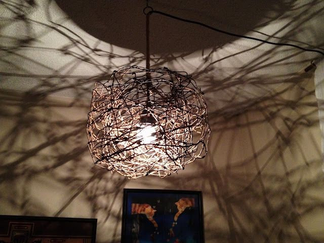 old wire fencing shaped into a lampshade of sorts... makes the most wonderful shadows!
