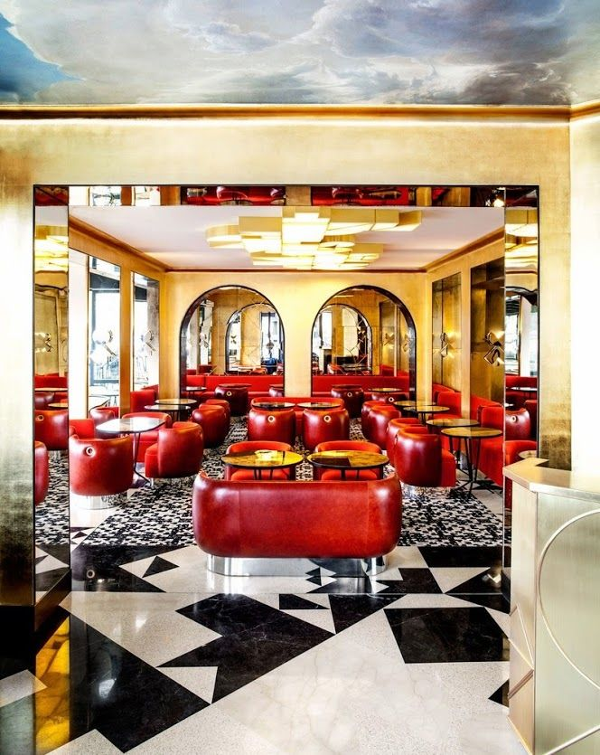 Café Français in Paris features a red dining room accented with gold