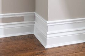 Make your baseboard more dramatic...add small pieces of trim to the top of existing baseboard, add a few inches and add another piece of moulding. Paint the wall and trim white. Cheap and Easy!!!
